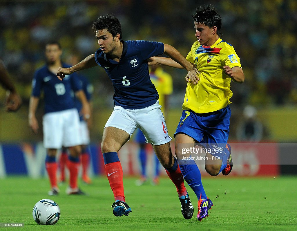 <a gi-track='captionPersonalityLinkClicked' href=/galleries/search?phrase=Clement+Grenier&family=editorial&specificpeople=5774493 ng-click='$event.stopPropagation()'>Clement Grenier</a> (L) of France shields Fernando Gaibor of Ecuador from the ball during the FIFA U-20 World Cup Colombia 2011 round of 16 match between France and Ecuador at the Estadio Olimpico Jaime Moron Leon on August 10, 2011 in Cartagena, Colombia.
