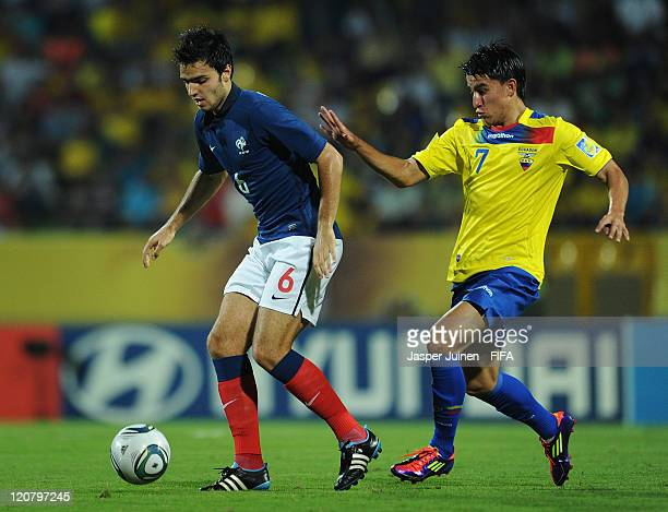 Clement Grenier of France shields Fernando Gaibor of Ecuador from the ball during the FIFA U20 World Cup Colombia 2011 round of 16 match between...