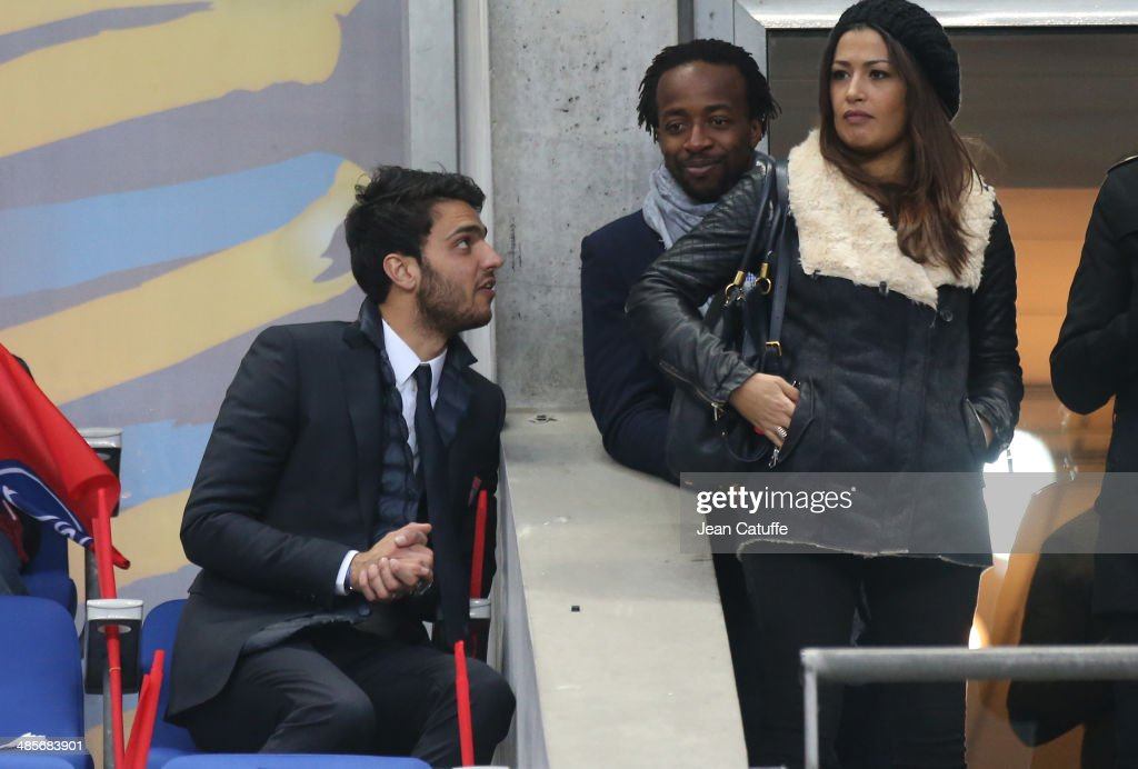Clement Grenier of Lyon and <a gi-track='captionPersonalityLinkClicked' href=/galleries/search?phrase=Sidney+Govou&family=editorial&specificpeople=242983 ng-click='$event.stopPropagation()'>Sidney Govou</a> attend the French League Cup Final (finale de la Coupe de la Ligue) between Olympique Lyonnais OL and Paris Saint-Germain FC at Stade de France on April 19, 2014 in Saint Denis near Paris, France.