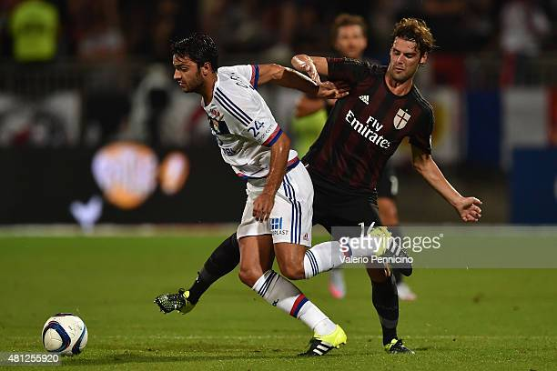 Clement Grenier of Olympique Lyonnais is challenged by Andrea Poli of AC Milan during the preseason friendly match between Olympique Lyonnais and AC...