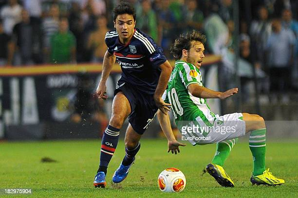 Clement Grenier of Olympique Lyonnais is challenged by Joan Verdu of Real Betis Balompie during the UEFA Europa League group stage match between Real...