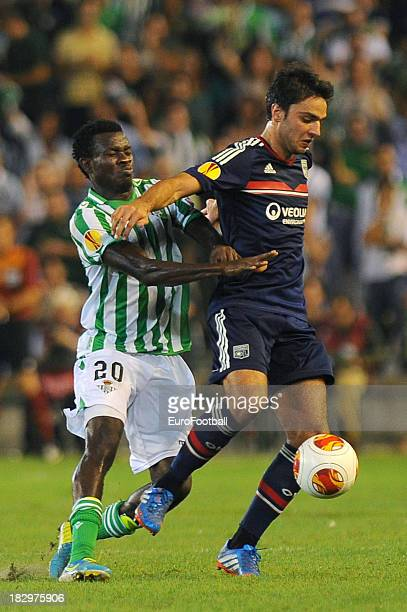 Clement Grenier of Olympique Lyonnais is challenged by Nosa of Real Betis Balompie during the UEFA Europa League group stage match between Real Betis...