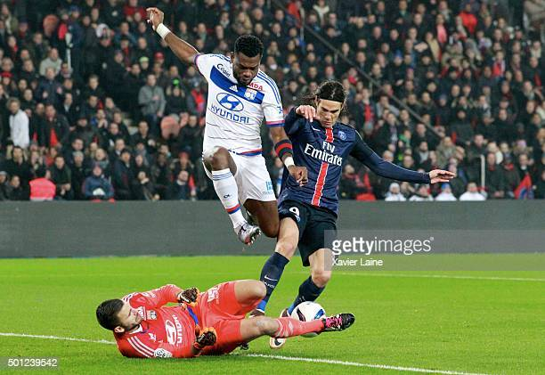 Clement Grenier of Olympique Lyonnais jumps over Anthony Lopes with Edinson Cavani of Paris SaintGermain during the French Ligue 1 between Paris...