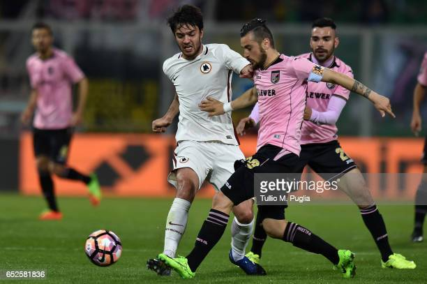 Clement Grenier of Roma and Ilija Nestorovski of Palermo compete for the ball during the Serie A match between US Citta di Palermo and AS Roma at...