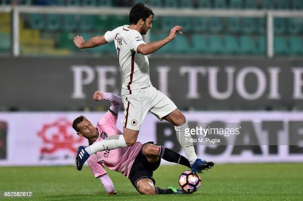 Clement Grenier of Roma in action as Alessandro Diamanti of Palermo tackles during the Serie A match between US Citta di Palermo and AS Roma at...