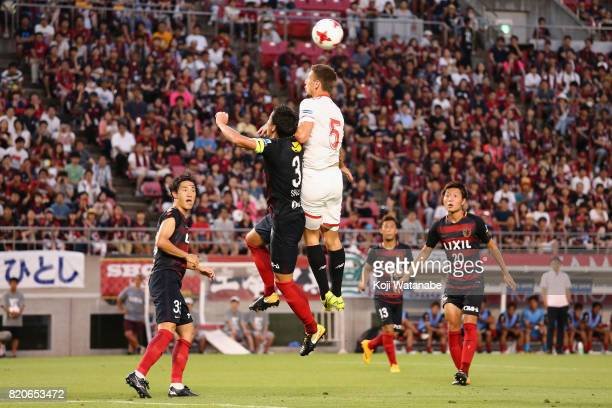 Clement Lenglet of Sevilla and Gen Shoji of Kashima Antlers compete for the ball during the preseason friendly match between Kashima Antlers and...