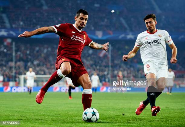 Clement Lenglet of Sevilla FC duels for the ball with Dejan Lovren of Liverpool FC during the UEFA Champions League group E match between Sevilla FC...