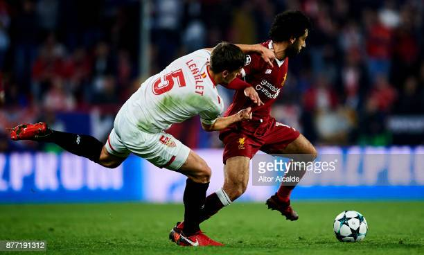Clement Lenglet of Sevilla FC duels for the ball with Mohamed Salah of Liverpool FC during the UEFA Champions League group E match between Sevilla FC...