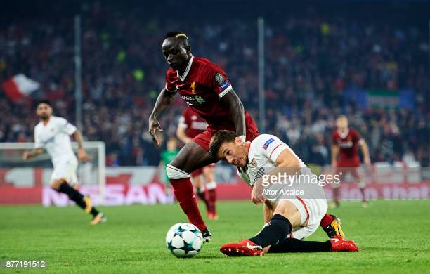 Clement Lenglet of Sevilla FC duels for the ball with Sadio Mane of Liverpool FC during the UEFA Champions League group E match between Sevilla FC...