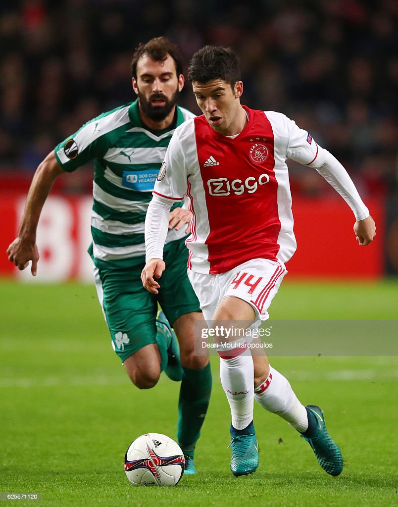 Clement of Ajax evades Giorgios Koutroubis of Panathinaikos during the UEFA Europa League Group G match between AFC Ajax and Panathinaikos FC at Amsterdam Arena on November 24, 2016 in Amsterdam, Netherlands.