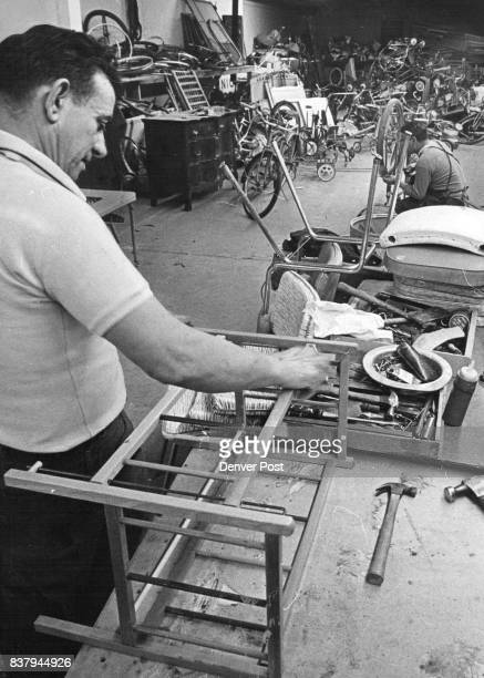 Clement Salazar foreground repairs furniture while Reuben O Benavidez works on a bicycle in background Nearly $300000 was grossed last year on items...