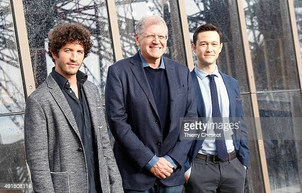 Clement Sibony Robert Zemeckis and Joseph Gordon Levitt attend the 'The Walk Rever Plus Haut' photocall at Eiffel Tower on October 6 2015 in Paris...