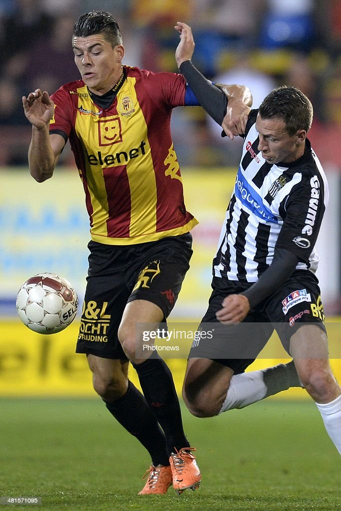 Clement Tainmont of Charleroi battles for the ball with Seth De Witte of KV Mechelen during the Jupiler Pro League play off 2 match between KV Mechelen and Royal Charleroi Sporting Club on March 30, 2014 in Mechelen, Belgium.