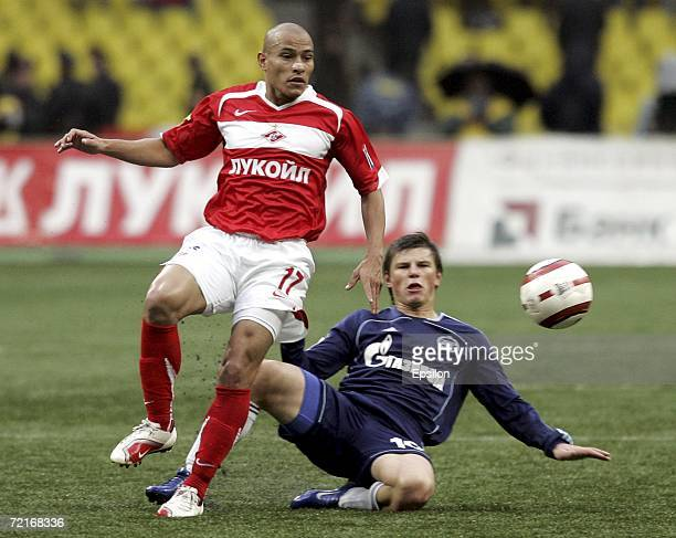 Clemente Rodriguez of Spartak Moscow competes for the ball with Andrey Arshavin of Zenit StPetersburg during the Football Russian League Championship...