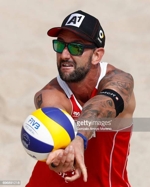 Clemmens Doppler from Austria bumps the ball during their quarter final match against Italy during the FIVB Beach Volleyball World Tour at the...