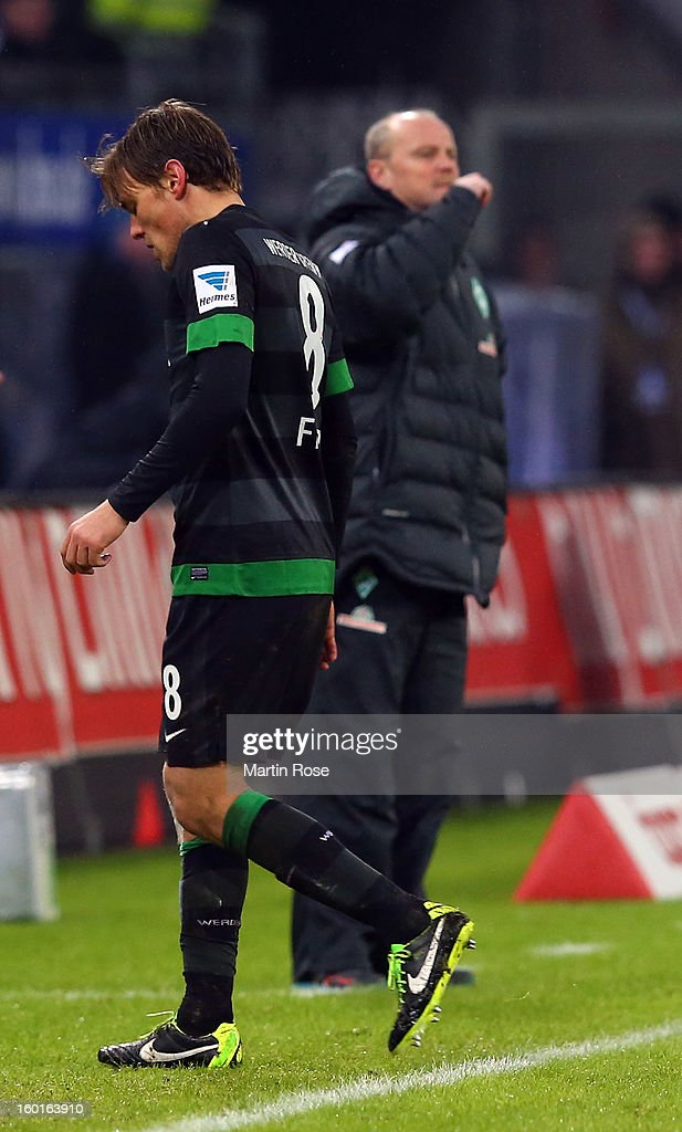 Clemns Fritz of Bremen walks off the itch after he gets the yellow red card during the Bundesliga match between Hamburger SV and SV Werder Bremen at Imtech Arena on January 27, 2013 in Hamburg, Germany.