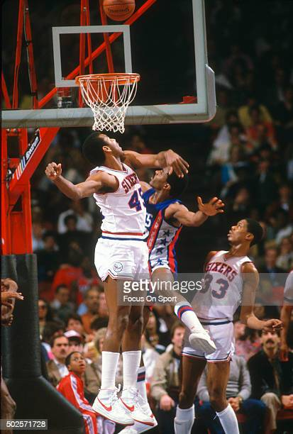 Clemon Johnson of the Philadelphia 76ers attempts to block the shot of Buck Williams of the New Jersey Nets during an NBA basketball game circa 1985...