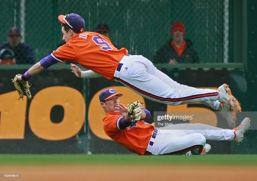 Clemson center fielder Thomas Brittle makes a diving catch underneath right fielder Steven Duggar (9) during the fourth inning against South Carolina at Fluor Field in Greenville, South Carolina, on Saturday, March 2, 2013. Clemson won, 6-3.