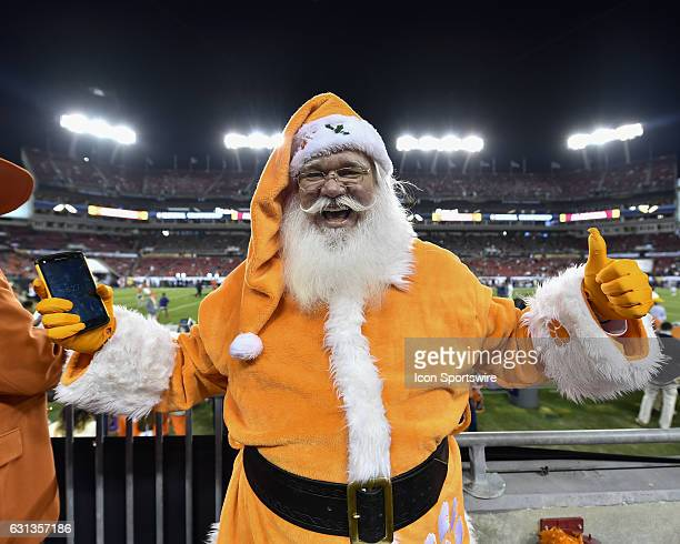 Clemson fan hopes his arrival brings gifts to his Tigers during the CFP National Championship game between the Alabama Crimson Tide and the Clemson...