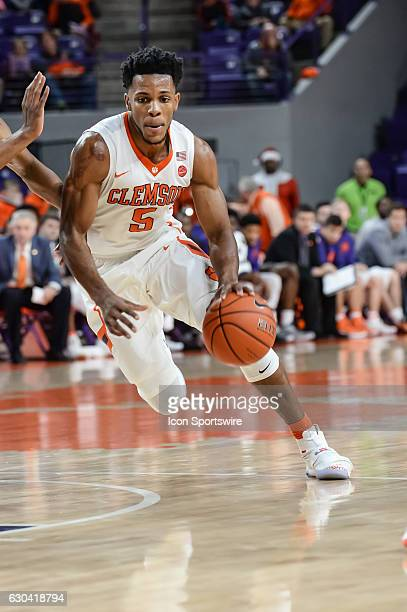 Clemson forward Jaron Blossomgame dribbles to the basket during 1st half action between the Clemson Tigers and South Carolina State Bulldogs on...