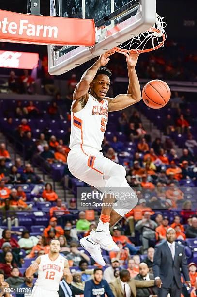 Clemson forward Jaron Blossomgame finishes a dunk during 1st half action between the Clemson Tigers and South Carolina State Bulldogs on December 13...