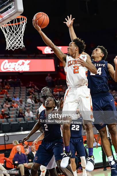 Clemson guard Marcquise Reed gets by South Carolina State's Ian Kinard during 2nd half action between the Clemson Tigers and the South Carolina State...