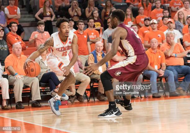 Clemson guard Marcquise Reed tries to get past Florida St guard Trent Forrest during 2nd half action between the Clemson Tigers and the Florida State...