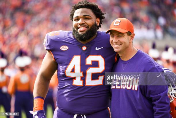 Clemson head coach Dabo Swinney poses with Clemson defensive lineman Christian Wilkins during senior day during pregame between the Clemson Tigers...