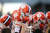 Clemson helmets are seen in a huddle during warmups for the NCAA Russell Athletic Bowl between the Clemson Tigers and the Oklahoma Sooners on...