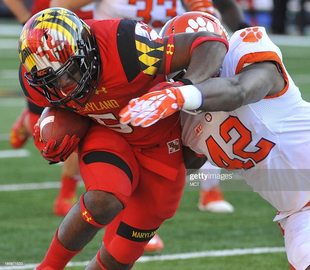 Clemson linebacker Stephone Anthony (42) tackles Maryland running back Albert Reid (5) during the first half at Byrd Stadium in College Park, Maryland, on Saturday, October 26, 2013. The Clemson Tigers defeated the Maryland Terrapins, 40-27.