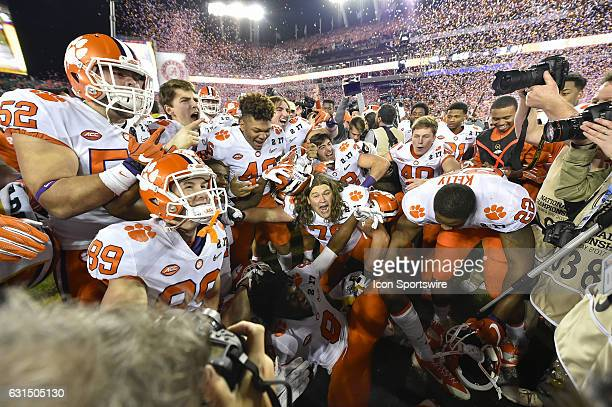 Clemson players begin to celebrate after the final whistle of the CFP National Championship game between the Alabama Crimson Tide and the Clemson...