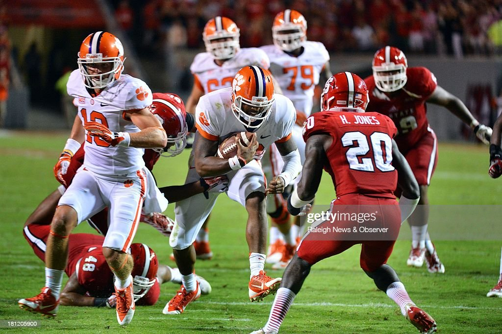 Clemson quarterback Tajh Boyd (10) breaks away for a second-quarter gain against the North Carolina State defense on Thursday, September 19, 2013, at Carter-Finley Stadium in Raleigh, North Carolina. Clemson won, 26-14.