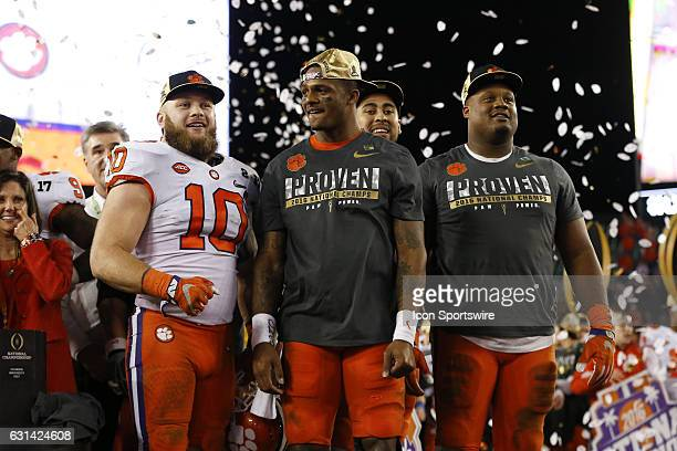 Clemson Tigers Ben Boulware Deshaun Watson Jordan Leggett and Carlos Watkins on stage for the trophy presentation after the 2017 College Football...