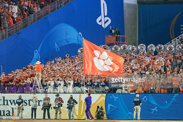 Clemson Tigers cheerleader waves the Tigers flag in the endzone after a touchdown during the Playstation Fiesta Bowl against the Ohio State Buckeyes...