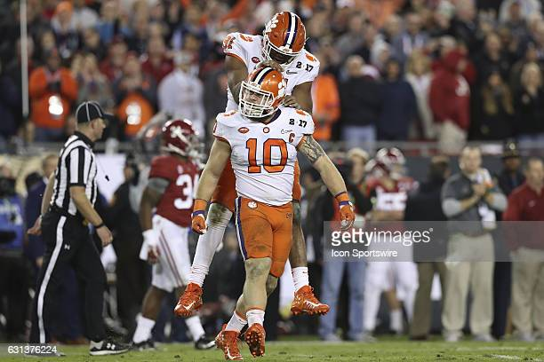 Clemson Tigers defensive end Austin Bryant and Clemson Tigers linebacker Ben Boulware celebrate after tackling Alabama Crimson Tide running back...
