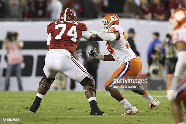 Clemson Tigers defensive end Clelin Ferrell is blocked by Alabama Crimson Tide offensive lineman Cam Robinson during the 2017 College Football...