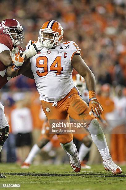 Clemson Tigers defensive tackle Carlos Watkins battles Alabama Crimson Tide offensive lineman Korren Kirven during the College Football Playoff...