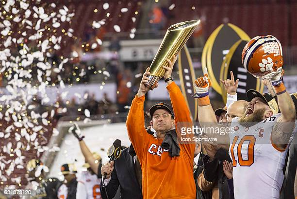 Clemson Tigers head coach Dabo Swinney and Clemson Tigers linebacker Ben Boulware celebrate the win after the College Football Playoff National...