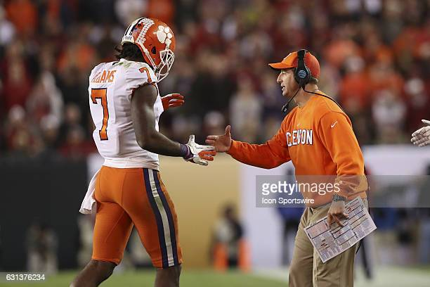 Clemson Tigers head coach Dabo Swinney congratulates Clemson Tigers wide receiver Mike Williams after he caught a pass for a touchdown in the 4th...