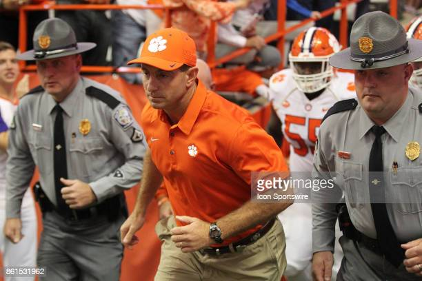 Clemson Tigers head coach Dabo Swinney is escorted onto the field during a college football game between Clemson Tigers and Syracuse Orange on...