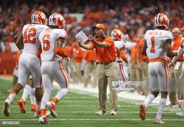 Clemson Tigers head coach Dabo Swinney talks to his team as they leave the field during a college football game between Clemson Tigers and Syracuse...