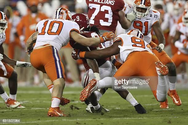 Clemson Tigers linebacker Ben Boulware and Clemson Tigers defensive tackle Carlos Watkins tackle Alabama Crimson Tide running back Bo Scarbrough...