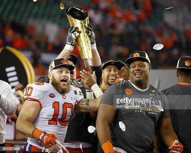 Clemson Tigers linebacker Ben Boulware and defensive tackle Carlos Watkins celebrate during the trophy presentation at the conclusion of the National...
