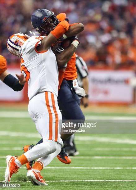 Clemson Tigers linebacker Dorian O'Daniel tackles Syracuse Orange running back Dontae Strickland during a college football game between Clemson...
