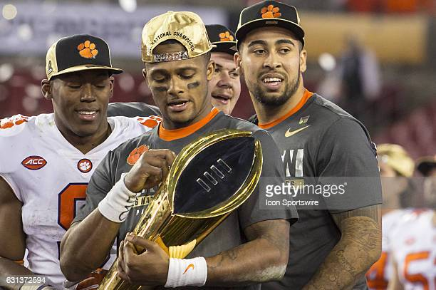 Clemson Tigers quarterback Deshaun Watson admires the trophy during the College Football Playoff National Championship game between the Alabama...