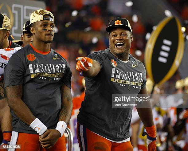 Clemson Tigers quarterback Deshaun Watson and defensive tackle Carlos Watkins celebrate during the trophy presentation at the conclusion of the...