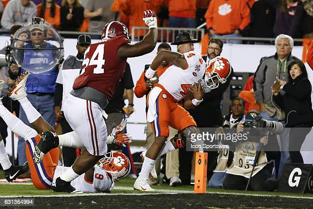Clemson Tigers quarterback Deshaun Watson runs the ball past Alabama Crimson Tide defensive lineman Dalvin Tomlinson for a touchdown in the 2nd...