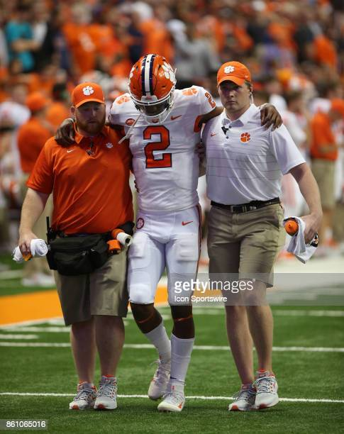 Clemson Tigers quarterback Kelly Bryant is helped off the field after being injured on a play during a college football game between Clemson Tigers...