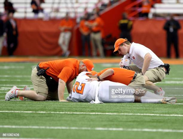 Clemson Tigers quarterback Kelly Bryant lays on the field motion less after being injured on a play during a college football game between Clemson...