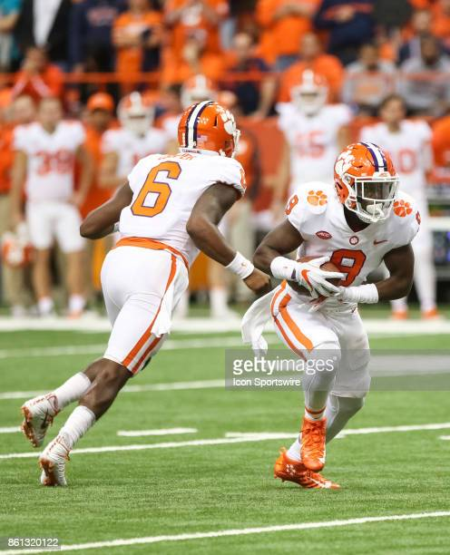 Clemson Tigers quarterback Zerrick Cooper hands the ball off to Clemson Tigers running back Travis Etienne during a college football game between...